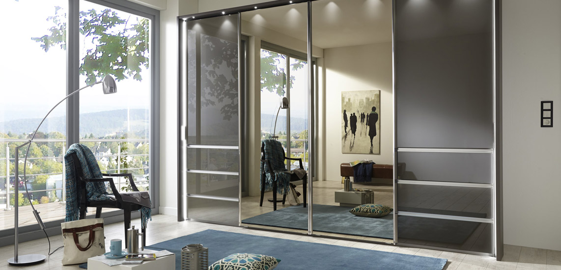 Malibu-by-Wiemann-sliding-robe-with-front-glass-in-graphite-mirrored-doors-with-drawer-pull-outs